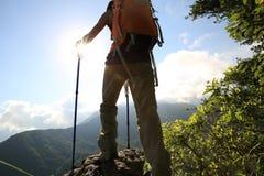 Woman hiker hiking on mountain peak. Successful young woman hiker hiking on mountain peak Stock Photos