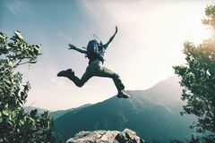 Woman jumping on cliff`s edge. Successful young woman  jumping on cliff`s edge Royalty Free Stock Photo