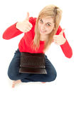 Successful young woman with laptop and thumbs up Royalty Free Stock Photography