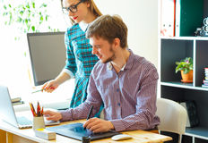 Successful young woman and man working from home Royalty Free Stock Photo