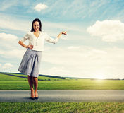 Successful young woman pointing at something Royalty Free Stock Images