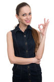 Successful young woman showing okay sign Stock Photography