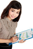 A successful young woman smiling and holding a clipboard Stock Photos