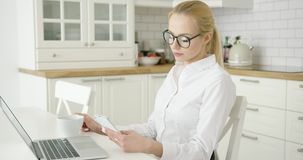 Successful young woman using devices stock video