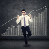 Successfull businessman and financial graph Royalty Free Stock Images