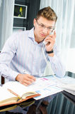 Successfull young business man speaking on the phone Stock Photos