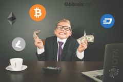 Successfully boy earning money with bitcoin cryptocurrency. royalty free stock images