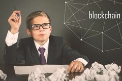 Successfully boy earning money with bitcoin cryptocurrency. stock photography