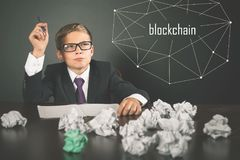 Successfully boy earning money with bitcoin cryptocurrency. stock photos