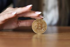 Successfully woman holds a Bitcoin. Crypto coin. Blockchain stock image