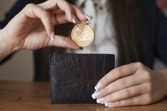 Successfully woman put a Bitcoin into wallet. Crypto coin saving. Savings money. Blockchain technology. Bitcoin cryptocurrency, bitcoin cash, market platform Stock Image