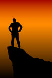 Succession man. Man on top of the mountain reaches for the sun Royalty Free Stock Image