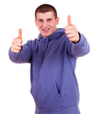 Successlul young male with thumb up Stock Photo