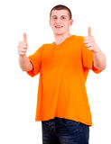 Successlul young male with thumb up Stock Photography