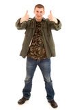 Successlul young male with thumb up Stock Images