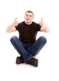 Successlul young male with thumb up Stock Photos