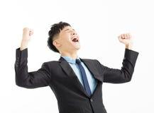 Successo di celebrazione dell'uomo d'affari con la mano su fotografia stock