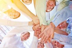 Successo e lavoro di squadra in un gruppo di affari Immagine Stock