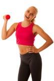 Successo sano di sport di stile di vita - allenamento biondo adatto della donna con la d Fotografia Stock Libera da Diritti