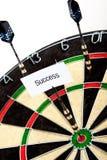 Successo sul dartboard fotografia stock
