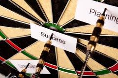 Successo sul dartboard fotografie stock