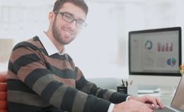 Successul business man working in an modern sunny office. Analyz Stock Image