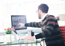 Successul business man working in an modern sunny office. Analyz Stock Photos