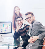 Successul business team working in an modern sunny office. Analy. Closeup photo young business managers working with new startup project in office royalty free stock image
