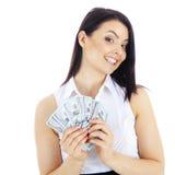 Succesvolle bedrijfsvrouw met in hand contant geld Stock Foto's
