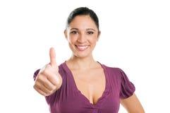 Succesvolle jonge vrouw die duim toont stock foto's