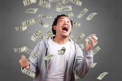 Succesvolle Mens in de Regen van Geld Stock Foto's