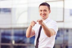 Succesvolle mens die op u richten Stock Fotografie