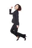Succesvolle onderneemster in kostuum blij springen royalty-vrije stock foto