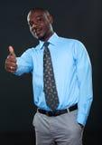 Succesvolle zakenman die duim toont Royalty-vrije Stock Afbeeldingen