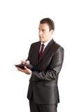 Succesvolle zakenman die in klembord schrijft stock foto's