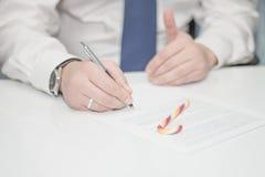 Succesvolle zakenman, een advocaat met suikergoed Royalty-vrije Stock Afbeeldingen