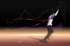 Succesvolle zakenman in een afwerkingslijn Stock Fotografie