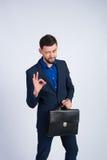 Succesvolle zakenman in een blauw kostuum Royalty-vrije Stock Afbeelding