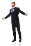 Succesvolle zakenman met open handen Stock Afbeeldingen