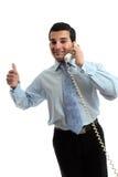 Succesvolle zakenman op telefoon stock foto