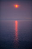 Red Sun over the sea Stock Images