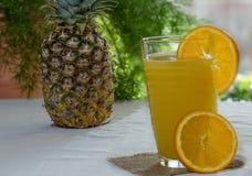 succo Ananas-arancio Fotografia Stock Libera da Diritti