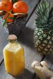 Succo arancio dello zenzero dell'ananas Fotografia Stock