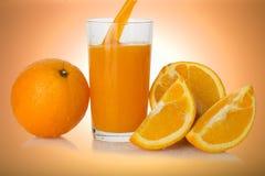 Succo d'arancia con l'arancia Fotografia Stock