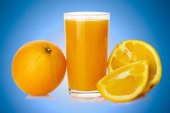 Succo d'arancia con l'arancia Fotografie Stock