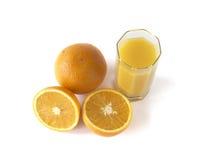 Succo d'arancia con le arance fresche Immagini Stock