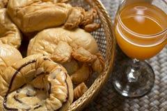 Succo d'arancia e pane Fotografia Stock