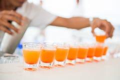 Succo d'arancia fresco in vetri di colpo Immagine Stock