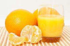 Succo del mandarino e dell'arancia Fotografie Stock