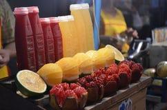 Succo del melograno e del succo d'arancia Fotografie Stock
